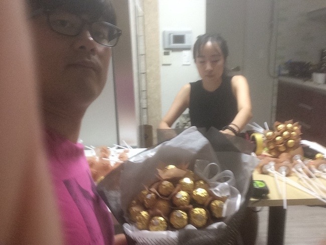 A photo of Brandy and I working on our Chocolate Bouquets at Home
