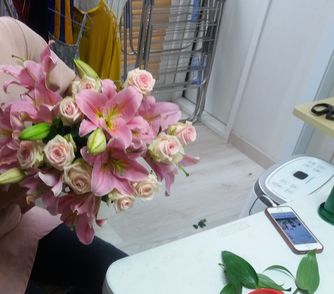 Arranging Flowers at home for a customer