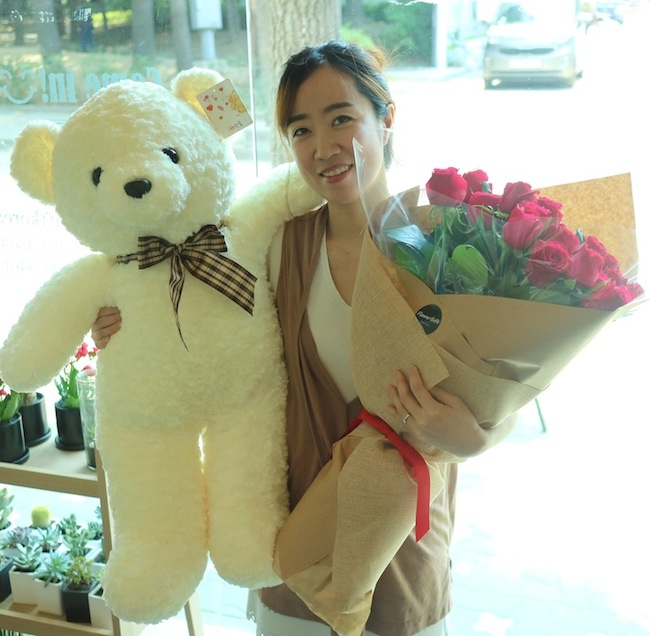 Extra large teddy bear, long stem roses, and cake